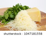parmesan cheese on a wooden... | Shutterstock . vector #1047181558
