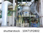vertical mill in cement factory. | Shutterstock . vector #1047192802
