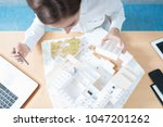 woman making a model of a...   Shutterstock . vector #1047201262