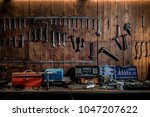 workshop scene. old tools... | Shutterstock . vector #1047207622