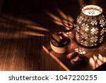 dates in wooden bowl and... | Shutterstock . vector #1047220255
