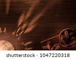 dates in wooden bowl and... | Shutterstock . vector #1047220318
