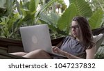 woman working on laptop while...   Shutterstock . vector #1047237832