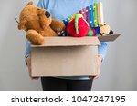 male volunteer holding donation ... | Shutterstock . vector #1047247195