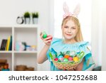 teenage girl holding easter eggs | Shutterstock . vector #1047252688
