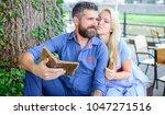 romantic couple holds old books ... | Shutterstock . vector #1047271516