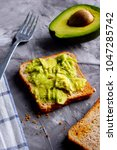 avocado and toast with avocado | Shutterstock . vector #1047285742