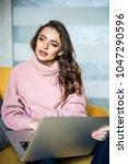 caucasian woman using laptop...   Shutterstock . vector #1047290596