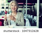 mature woman 50s years old is...   Shutterstock . vector #1047312628
