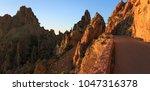 last light at the road along... | Shutterstock . vector #1047316378