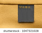 care clothes label on yellow...   Shutterstock . vector #1047321028