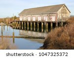 An Old Wooden Boathouse Used...