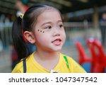 portrait of asian child girl...   Shutterstock . vector #1047347542