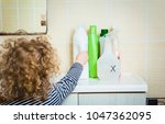 little child reaches out to... | Shutterstock . vector #1047362095