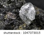 natural diamond nestled in... | Shutterstock . vector #1047373015