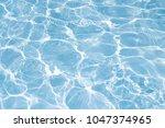 texture of water in swimming... | Shutterstock . vector #1047374965