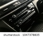 luxury car interior   radio and ... | Shutterstock . vector #1047378835