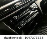 luxury car interior   radio and ... | Shutterstock . vector #1047378835
