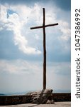 Cross On Cloudy Sky Background. ...