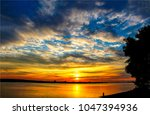 sunset sky clouds over river... | Shutterstock . vector #1047394936