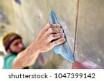Climber Bouldering In A Sports...