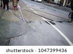 crossing tram rails on the... | Shutterstock . vector #1047399436