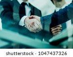 concept of partnership  ... | Shutterstock . vector #1047437326