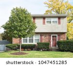 small two story house with... | Shutterstock . vector #1047451285