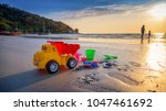 summer children's toys on the... | Shutterstock . vector #1047461692