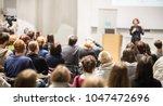 female speaker giving... | Shutterstock . vector #1047472696