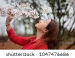 Small photo of A asian girl is intoxicated with sakura.