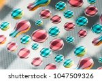 colorful water drops over... | Shutterstock . vector #1047509326