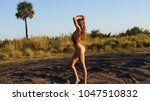 fit beautiful blonde young... | Shutterstock . vector #1047510832