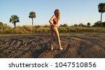beautiful young blonde woman... | Shutterstock . vector #1047510856