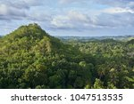 famous chocolate hills view ... | Shutterstock . vector #1047513535