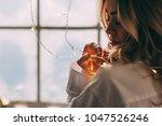 portrait of a blonde in a shirt. | Shutterstock . vector #1047526246