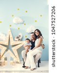 happiness and beautiful family | Shutterstock . vector #1047527206