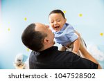 hapiness and beatiful family | Shutterstock . vector #1047528502