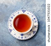cup of tea on a blue stone... | Shutterstock . vector #1047531022