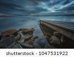 pier or jetty  sunset blue... | Shutterstock . vector #1047531922