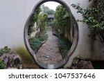 doorway in suzhou | Shutterstock . vector #1047537646