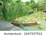 thai boat in the lotus pond... | Shutterstock . vector #1047537922