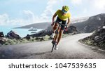 professional road bicycle racer ... | Shutterstock . vector #1047539635