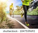 professional triathlon man and... | Shutterstock . vector #1047539692
