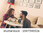 couple in love sitting on a... | Shutterstock . vector #1047540526
