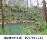 river thru the woods   Shutterstock . vector #1047553252