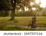 mother and son in the sunset... | Shutterstock . vector #1047557116