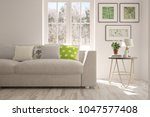 white room with sofa and winter ... | Shutterstock . vector #1047577408
