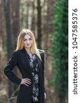 portrait of a blonde woman... | Shutterstock . vector #1047585376