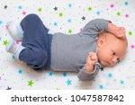 portrait of a cute newborn baby ... | Shutterstock . vector #1047587842